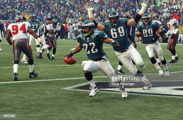 Running back Duce Staley of the Philadelphia Eagles scores the first touchdown of the NFC Championship game against the Tampa Bay Buccanneers at...