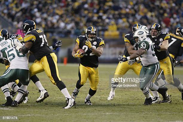Running back Duce Staley of the Pittsburgh Steelers runs the ball behind the blocking of tackle Oliver Ross and guards Keydrick Vincent and Alan...