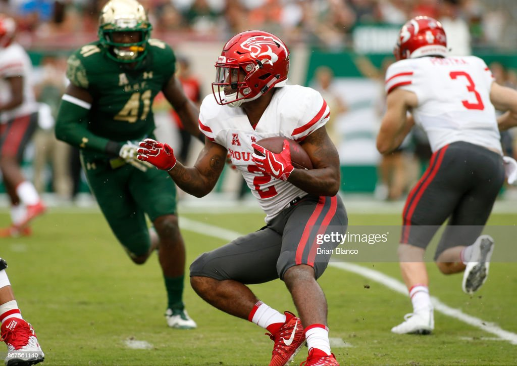 Running back Duke Catalon #2 of the Houston Cougars runs for several yards during the first quarter of an NCAA football game against the South Florida Bulls on October 28, 2017 at Raymond James Stadium in Tampa, Florida.
