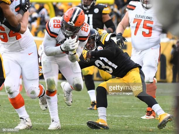 Running back Duke Johnson Jr #29 of the Cleveland Browns breaks the tackle of cornerback Mike Hilton of the Pittsburgh Steelers in the fourth quarter...