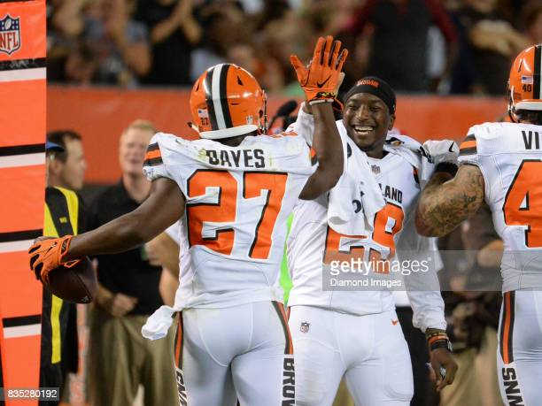 Running back Duke Johnson Jr #29 of the Cleveland Browns greets running back Matthew Dayes after a rushing touchdown by Dayes in the second quarter...