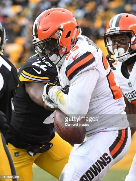Running back Duke Johnson Jr #29 of the Cleveland Browns is stripped by cornerback William Gay of the Pittsburgh Steelers in the fourth quarter of a...