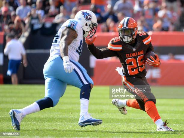 Running back Duke Johnson Jr #29 of the Cleveland Browns stiff arms defensive tackle Jurrell Casey of the Tennessee Titans in the second quarter of a...