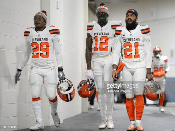 Running back Duke Johnson Jr #29 wide receiver Josh Gordon and cornerback Jamar Taylor of the Cleveland Browns walk down the tunnel toward the field...