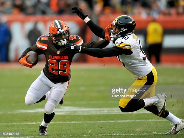 Running back Duke Johnson of the Cleveland Browns carries the ball as he stiff arms linebacker Ryan Shazier of the Pittsburgh Steelers during a game...