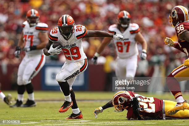 Running back Duke Johnson of the Cleveland Browns carries the ball past defensive back Greg Toler of the Washington Redskins in the second quarter at...