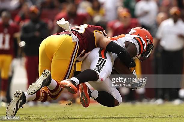 Running back Duke Johnson of the Cleveland Browns is tackled by defensive end Trent Murphy of the Washington Redskins in the second quarter at...
