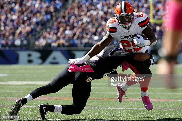 Running back Duke Johnson of the Cleveland Browns is tackled by cornerback Jimmy Smith of the Baltimore Ravens in the second quarter of a game at MT...
