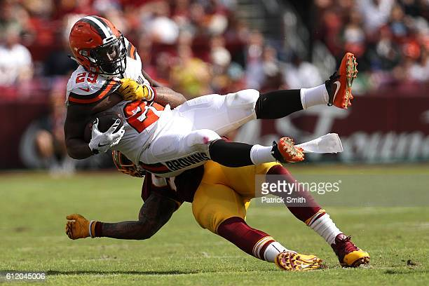 Running back Duke Johnson of the Cleveland Browns is tackled by inside linebacker Mason Foster of the Washington Redskins in the third quarter at...