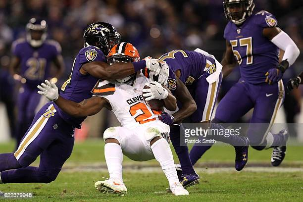 Running back Duke Johnson of the Cleveland Browns is tackled by multiple Baltimore Ravens defenders at MT Bank Stadium on November 10 2016 in...