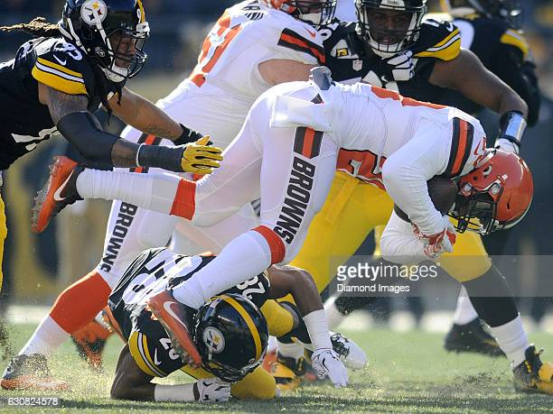 Running back Duke Johnson of the Cleveland Browns is tackled by linebacker Jarvis Jones and safety Sean Davis of the Pittsburgh Steelers during a...