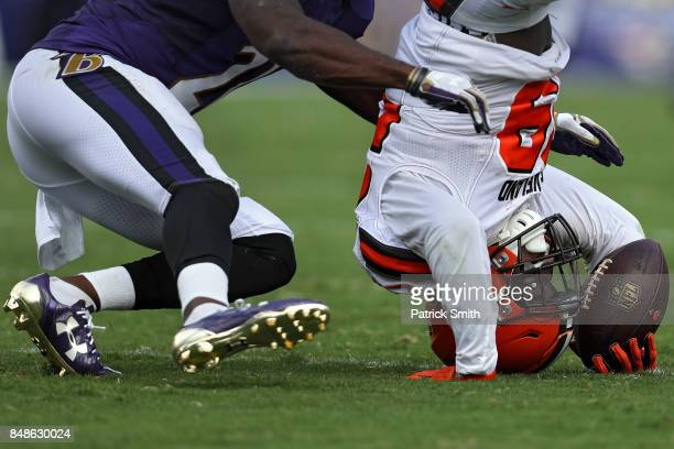 Running back Duke Johnson of the Cleveland Browns makes a catch as he is tackled by free safety Lardarius Webb of the Baltimore Ravens in the third...