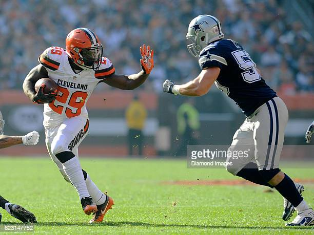 Running back Duke Johnson of the Cleveland Browns prepares to stiffarm linebacker Sean Lee of the Dallas Cowboys during a game on November 6 2016 at...