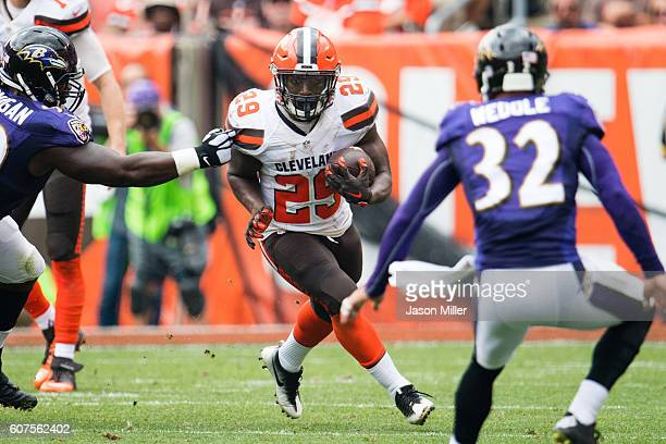 Running back Duke Johnson of the Cleveland Browns runs for a gain during the first half against the Baltimore Ravens at FirstEnergy Stadium on...