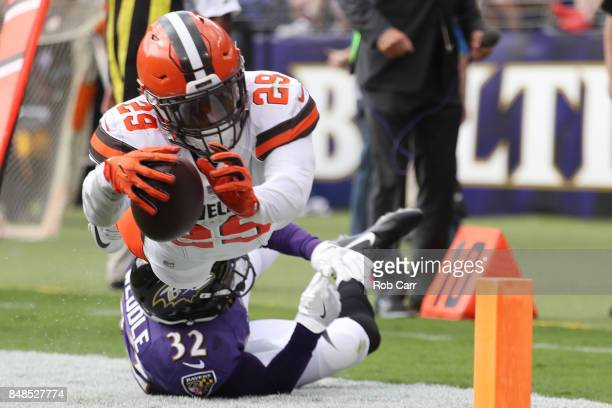 Running back Duke Johnson of the Cleveland Browns runs towards the end zone as free safety Eric Weddle of the Baltimore Ravens tackles him in the...