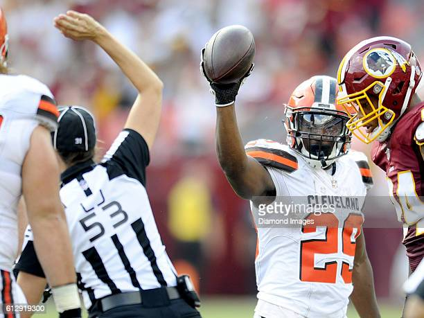 Running back Duke Johnson of the Cleveland Browns shows the ball to line judge Sarah Thomas after she signals a fumble recovery for Washington during...