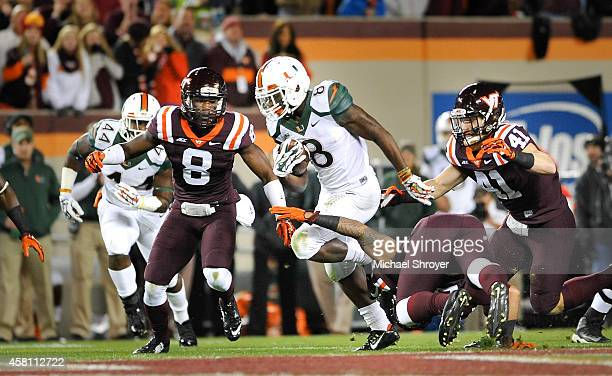 Running back Duke Johnson of the Miami Hurricanes rushes the ball in the first half against the Virginia Tech Hokies at Lane Stadium on October 23...