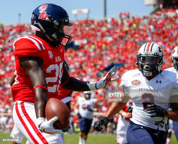 Running back D'Vaughn Pennamon of the Mississippi Rebels carries the ball in for a touchdown against the Tennessee Martin Skyhawks during the first...
