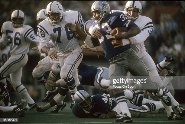 Running back Dwayne Thomas of the Dallas Cowboys is wrapped up by linebacker Mike Curtis of the Baltimore Colts January 17 1971 during Super Bowl V...