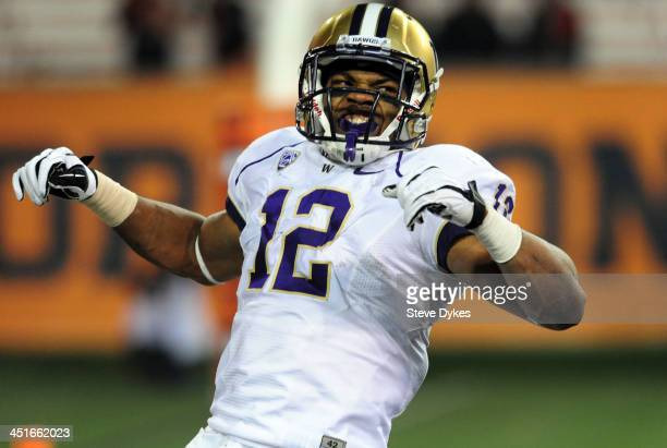 Running back Dwayne Washington of the Washington Huskies celebrates a touchdown during the fourth quarter of the game against the Oregon State...