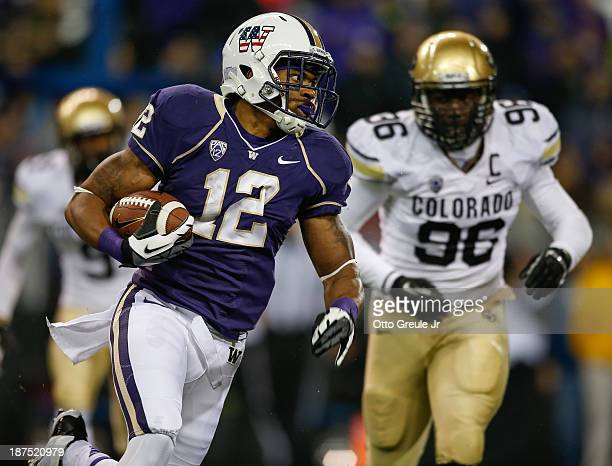 Running back Dwayne Washington of the Washington Huskies rushes for a touchdown in the fourth quarter against the Colorado Buffaloes on November 9,...