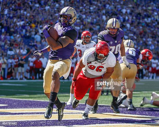 Running back Dwayne Washington of the Washington Huskies rushes for a touchdown in the first half against the Eastern Washington Eagles on September...