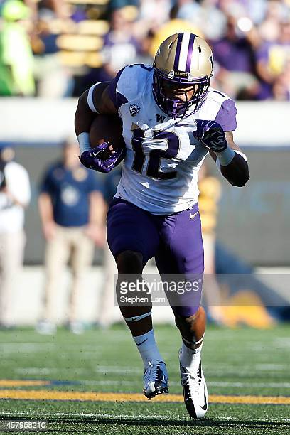 Running back Dwayne Washington of the Washington Huskies rushes up the field during the second quarter of his game against the California Golden...