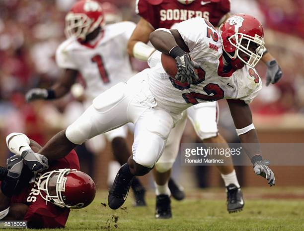 Running back Dwayne Wright of the Fresno State Bulldogs is tackled by defensive back Donte Nicholson of the University of Oklahoma Sooners at Gaylord...