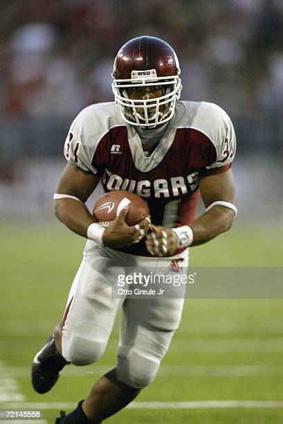 Running back Dwight Tardy of the Washington State Cougars carries the ball against the USC Trojans on September 30 2006 at Martin Stadium in Pullman...