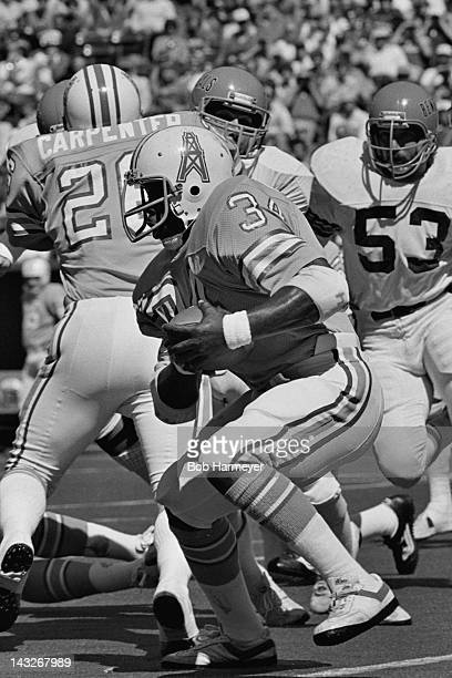 Running back Earl Campbell of the Houston Oilers carries the ball against the Cincinnati Bengals on September 23 at Riverfront Stadium in Cincinnati...