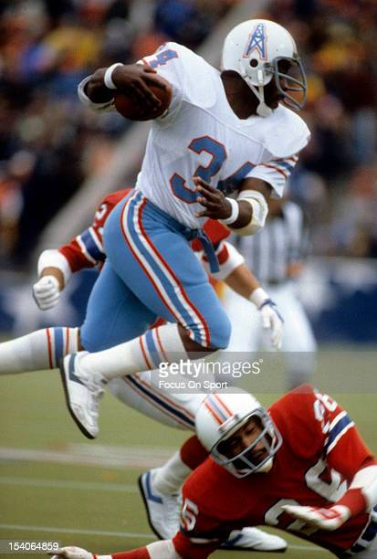 Running back Earl Campbell of the Houston Oilers carries the ball against the New England Patriots during an NFL game at Schaefer Stadium in Foxboro...