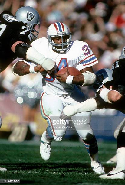 Running Back Earl Campbell of the Houston Oilers carries the ball against the Los Angeles Raiders September 11 1983 during an NFL football game at...