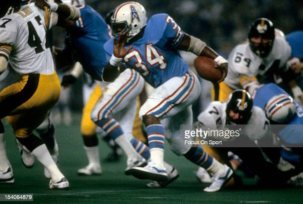 Running Back Earl Campbell of the Houston Oilers carries the ball against the Pittsburgh Steelers during an NFL football game December 4 1980 at the...