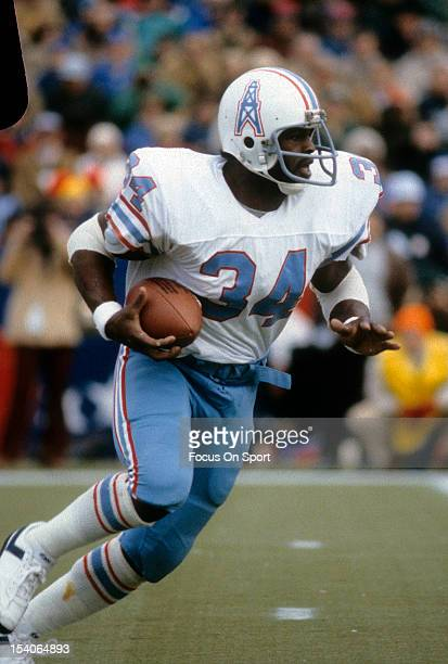 Running back Earl Campbell of the Houston Oilers carries the ball against the New England Patriots during an NFL game October 18 1981 at Schaefer...