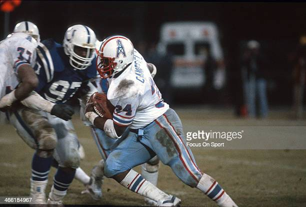 Running Back Earl Campbell of the Houston Oilers carries the ball against the Baltimore Colts during an NFL football game December 18 1983 at...