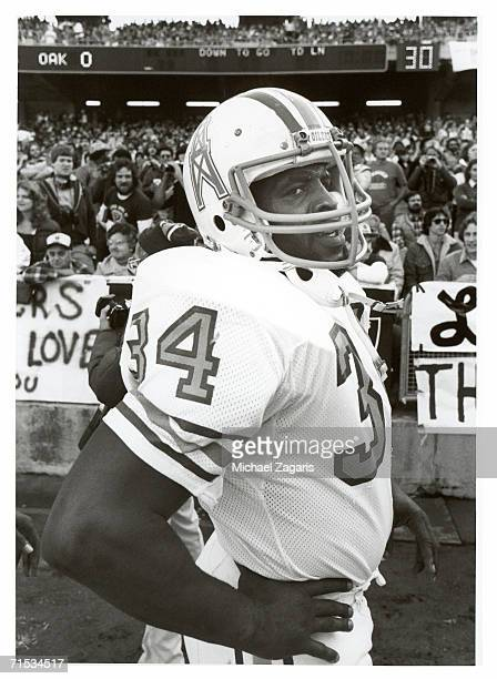 Running back Earl Campbell of the Houston Oilers stands on the sideline during the 1980 AFC Wild Card Playoff Game against the Oakland Raiders at...