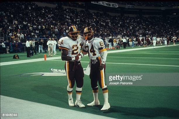Running back Earnest Byner of the Washington Redskins is congratulated by wide receiver Gary Clark after scoring on a 3yard run against the Minnesota...