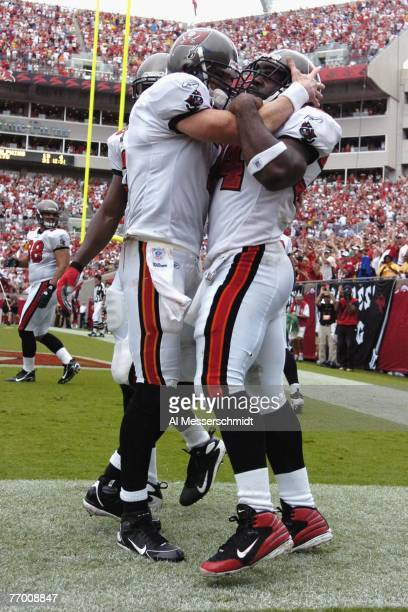 Running back Earnest Graham and quarterback Jeff Garcia of the Tampa Bay Buccaneers celebrate a touchdown against the St Louis Rams at Raymond James...