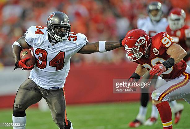 Running back Earnest Graham of the Tampa Bay Buccaneers rushes up field against pressure from linebacker Cory Greenwood of the Kansas City Chiefs...