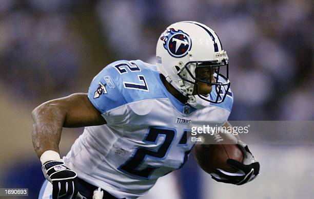 Running Back Eddie George of the Tennessee Titans advances the ball during the NFL game against the Indianapolis Colts at the RCA Dome on November...