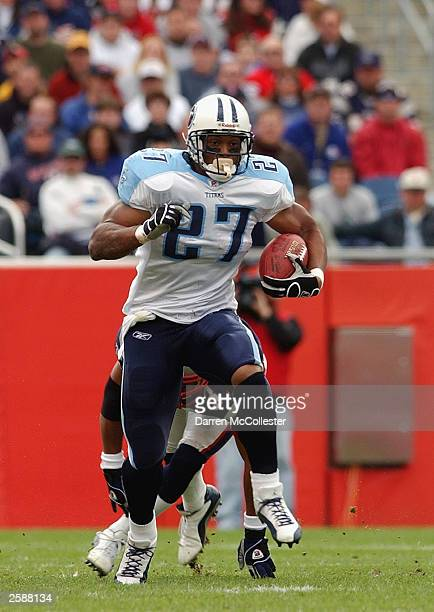 Running back Eddie George of the Tennessee Titans carries the ball against the New England Patriots at Gillette Stadium on October 5 2003 in Foxboro...
