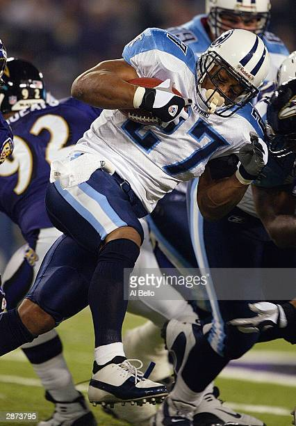 Running back Eddie George of the Tennessee Titans carries the ball during the AFC Wildcard playoff game against the Baltimore Ravens at M T Bank...