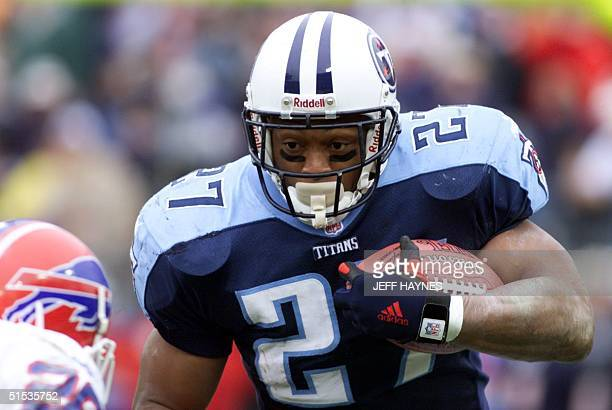 Running back Eddie George of the Tennessee Titans heads toward Donovan Greer of the Buffalo Bills during the first half of their AFC Wild Card Game...