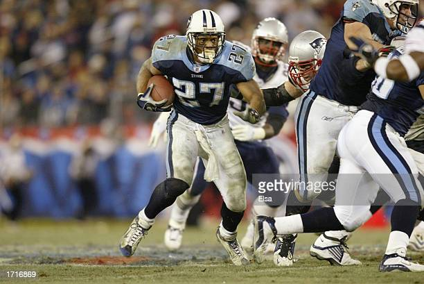 Running back Eddie George of the Tennessee Titans runs the ball during the NFL game against the New England Patriots at the Coliseum on December 16...