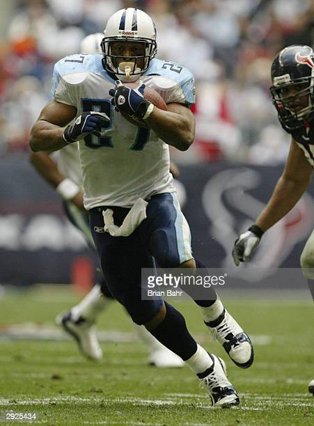 Running back Eddie George of the Tennessee Titans runs the ball during the game against the Houston Texans on December 21 2003 at Reliant Stadium in...