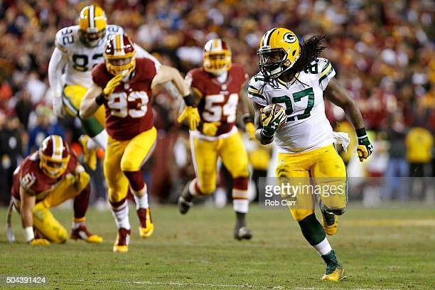 Running back Eddie Lacy of the Green Bay Packers carries the ball past inside linebacker Will Compton inside linebacker Mason Foster and outside...