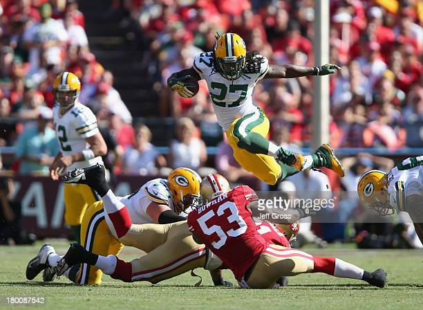 Running back Eddie Lacy of the Green Bay Packers leaps over NaVorro Bowman of the San Francisco 49ers in the fourth quarter at Candlestick Park on...