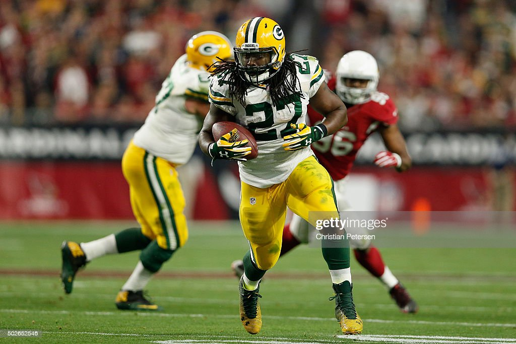 Running back Eddie Lacy #27 of the Green Bay Packers rushes the football 28 yards to score a touchdown against the Arizona Cardinals in the third quarter during the NFL game at the University of Phoenix Stadium on December 27, 2015 in Glendale, Arizona. The Cardinals defeated the Packers 38-8.