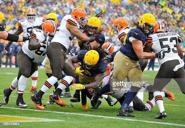 Running back Eddie Lacy of the Green Bay Packers scores on a 1yard run during the first quarter against the Cleveland Browns at Lambeau Field on...