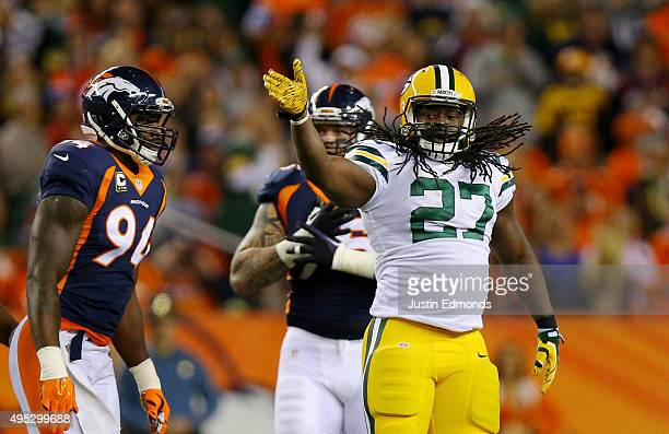 Running back Eddie Lacy reacts after being upended by TJ Ward of the Denver Broncos to get a first down in the first quarter at Sports Authority...